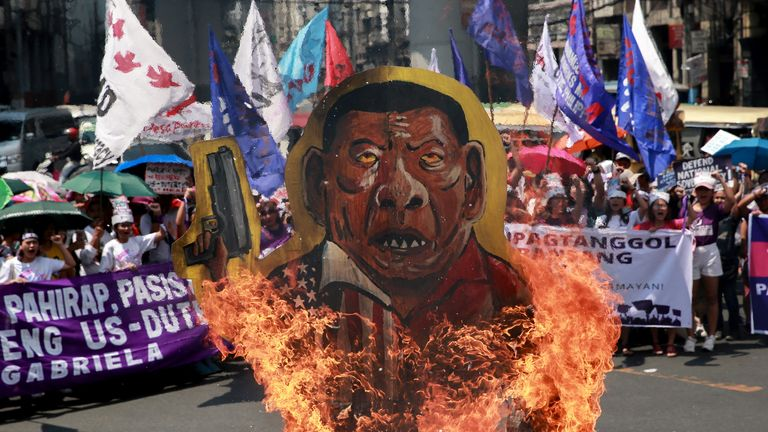 Protesters in the Philippines burned effigies of the president