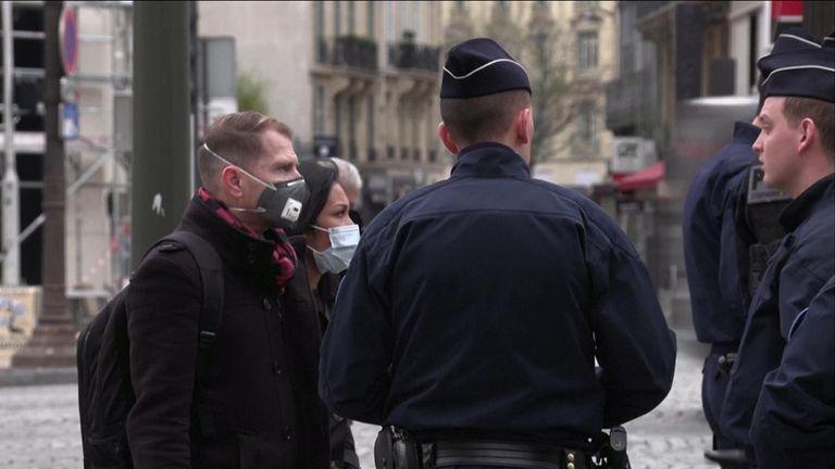 French police enforce a night-time curfew