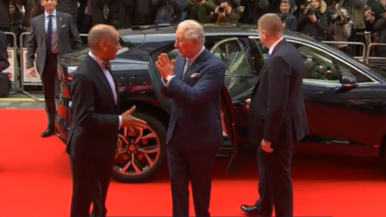 Prince Charles avoids handshakes at London awards show