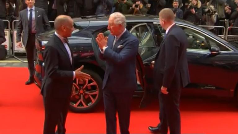 Prince Charles avoids handshakes at London awards show