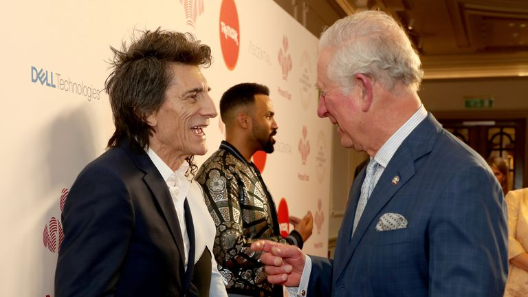 The Prince of Wales speaks with Rolling Stone Ronnie Wood as he arrives at the annual Prince's Trust Awards 2020 held at the London Palladium.