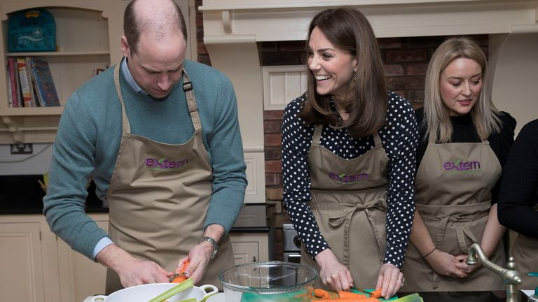 The couple helped prepare a meal in the kitchen at Savannah House, a social justice charity