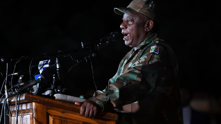 South African President Cyril Ramaphosa dressed in military fatigues talks to soldiers of the South African National Defence Force (SANDF) at the Doornkop Military Base in Soweto, on March 26, 2020
