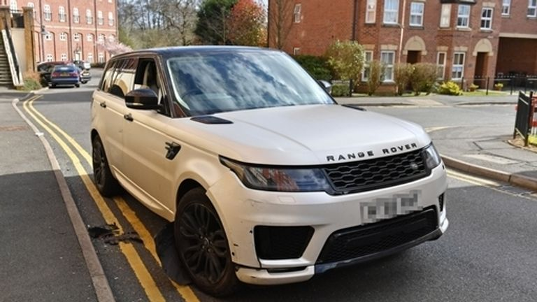 A damaged white Range Rover after reports of a crash in Solihull