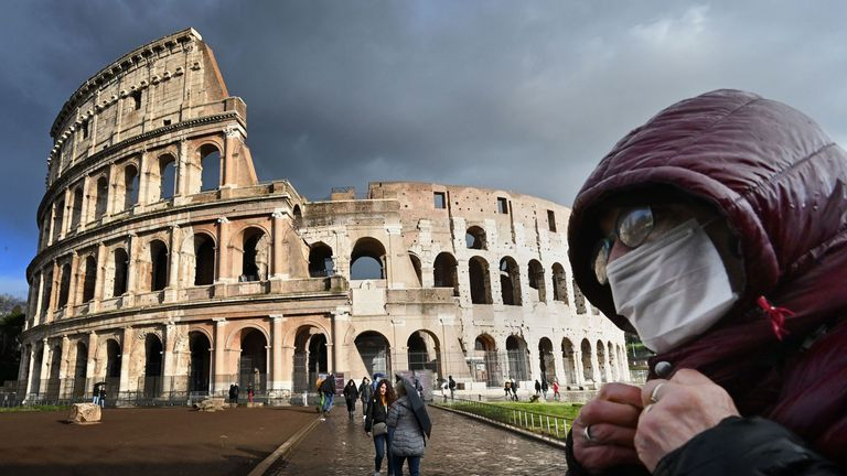 A tourist wears a face mask in Rome