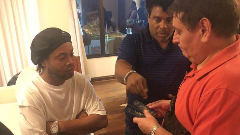A handout photo made available by the Paraguayan Prosecutor's Office shows former professional soccer player Ronaldinho (L) surrounded by paraguayan authorities as they search his hotel room in Asuncion, Paraguay, 04 March 2020, Paraguay, 04 March 2020. The Paraguayan Prosecutor's Office ordered the arrest of Ronaldinho for alleged possession of altered passports, hours after the Brazilian former player entered Paraguay. Ronaldinho was allowed to remain in his hotel under custody.  4 Mar 2020