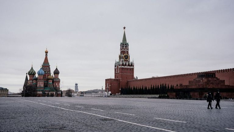 Moscow 's Red square is empty other than for police on 30 March