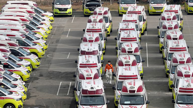 Ambulances wait to transport infected patients from Daegu, South Korea