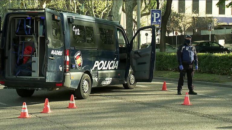 Police in Spain patrol the streets to prevent the spread of coronavirus.