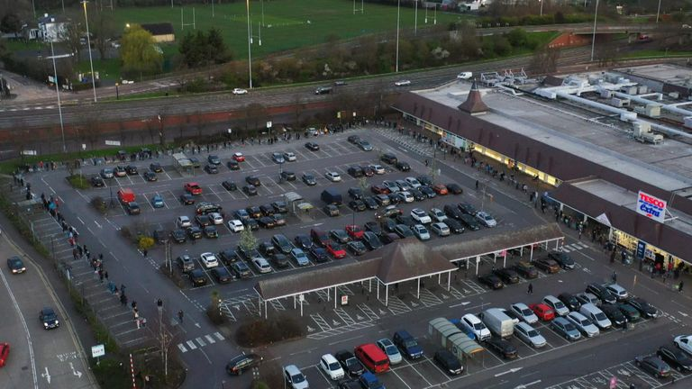 Shoppers queue outside Tesco