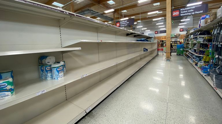 Empty toilet paper shelves in Sainsbury's