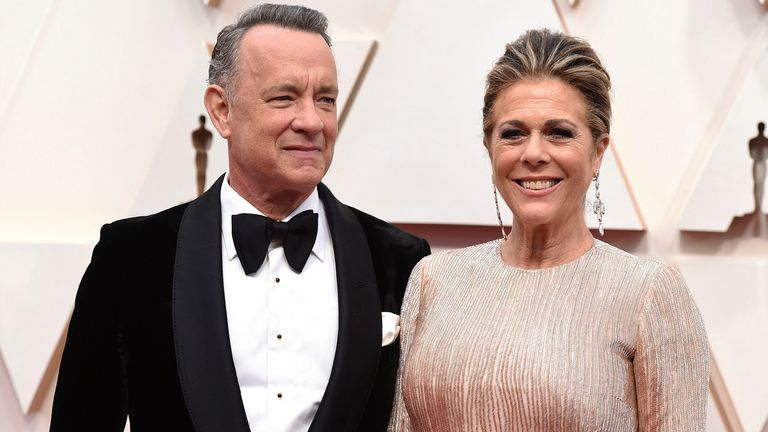 FILE- In this Feb. 9, 2020 file photo, Tom Hanks, left, and Rita Wilson arrive at the Oscars at the Dolby Theatre in Los Angeles. ***** Hanks announces on Instagram that he and his wife Rita, who are both in Australia, have both tested positive for #COVID19. Both felt ill and were tested. ***** (Photo by Jordan Strauss/Invision/AP, File)