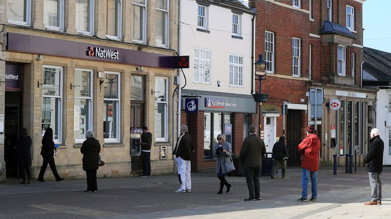 Members of the public queue to enter a Natwest bank in Melton Mowbray as the UK continues in lockdown to help curb the spread of the coronavirus. PA Photo. Picture date: Friday March 27, 2020. Photo credit should read: Mike Egerton/PA Wire