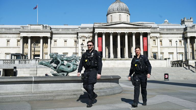 Police officers patrol in an empty Trafalgar Square in London the day after Prime Minister Boris Johnson put the UK in lockdown to help curb the spread of the coronavirus. PA Photo. Picture date: Tuesday March 24, 2020. See PA story HEALTH Coronavirus. Photo credit should read: Kirsty O'Connor/PA Wire