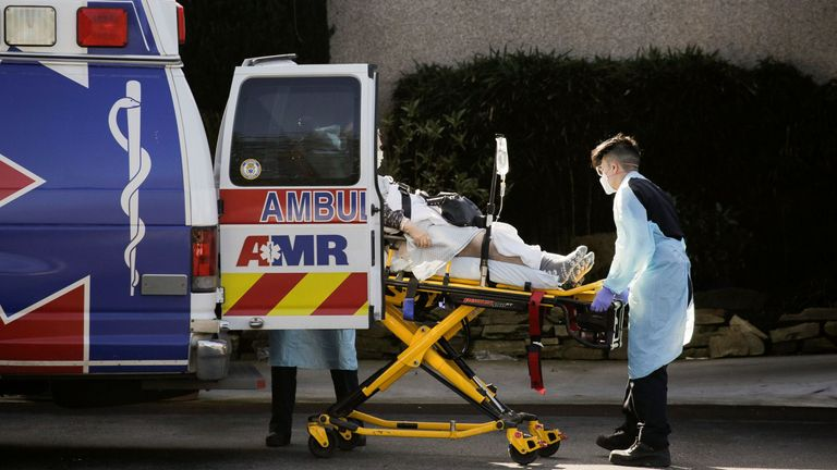 A person is loaded into an ambulance at the Life Care Center
