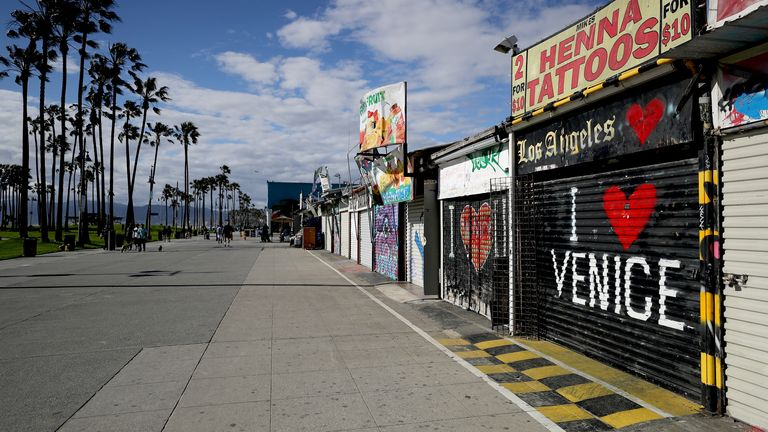 Many shops stand shuttered on the Venice Beach boardwalk in Venice, California
