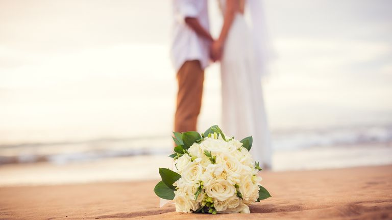 Just married couple holding hands on the beach, Hawaii Beach Wedding