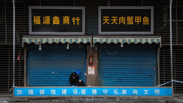 WUHAN, CHINA - JANUARY 17: (CHINA OUT) A security guard sits outside the closed Huanan Seafood Wholesale Market, which has been linked to cases of Coronavirus, on January 17, 2020 in Wuhan, Hubei province, China. Local authorities have confirmed that a second person in the city has died of a pneumonia-like virus since the outbreak started in December. (Photo by Getty Images)