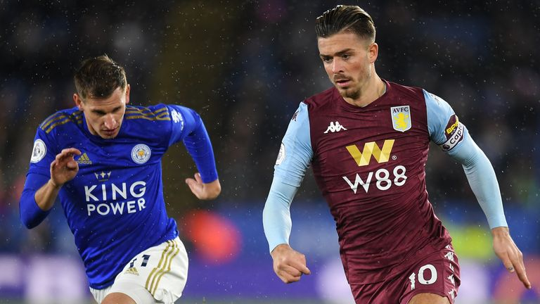Jack Grealish of Aston Villa gets past the tackle from Marc Albrighton of Leicester City
