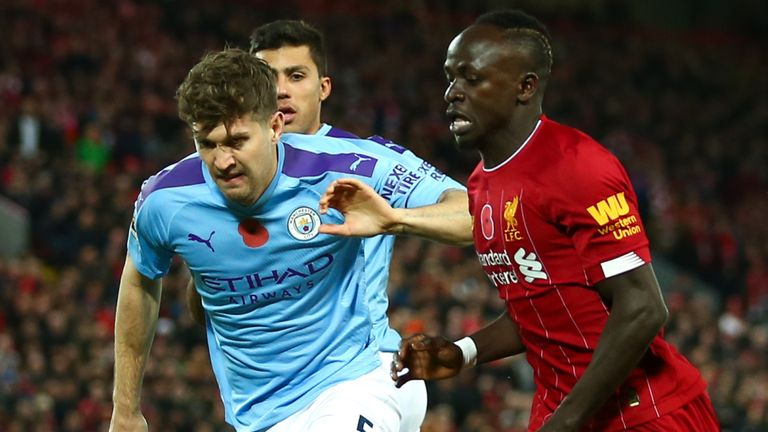 John Stones and Sadio Mane battle for possession at Anfield