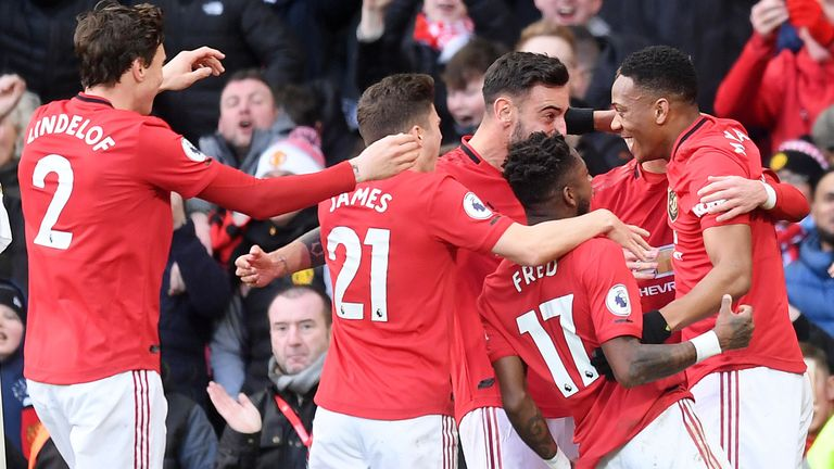 Man Utd players celebrate after Martial volleyed the hosts into the lead