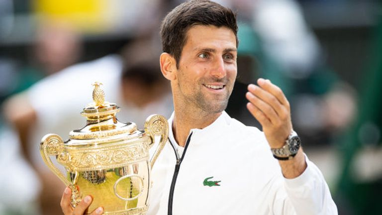 Novak Djokovic of Serbia with the winners trophy after defeating Roger Federer of Switzerland (not pictured) in the Men's Singles Final at The Wimbledon Lawn Tennis Championship at the All England Lawn and Tennis Club at Wimbledon on July 14, 2019 in London, England