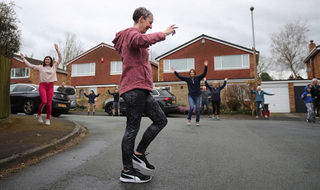 Coronavirus:  Entire street joins together for 'socially distant' dancing outside homes