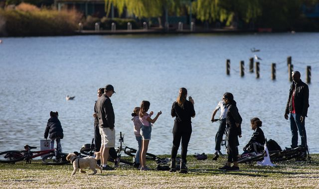 Coronavirus: Parks busy despite lockdown as many head out to enjoy the sun