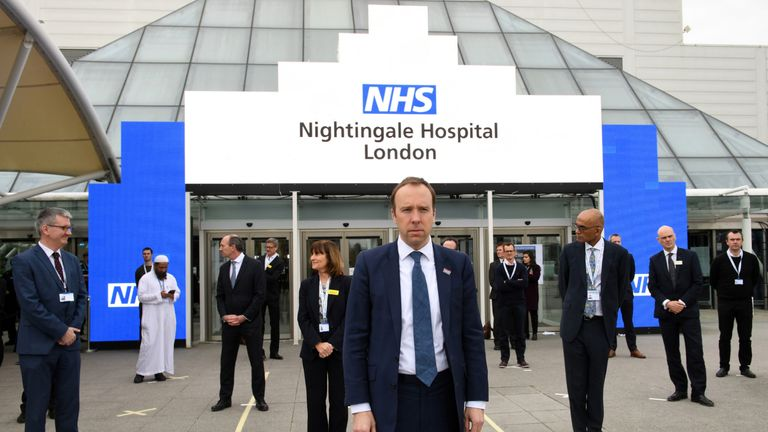 "Britain's Health Secretary Matt Hancock prepares for the opening of the ""NHS Nightingale"" field hospital, created at the ExCeL London exhibition centre, in London on April 3, 2020, to help with the novel coronavirus COVID-19 pandemic. - The new state-run National Health Service (NHS) hospital, named after trailblazing 19th-century nurse Florence Nightingale, has been built in just nine days. (Photo by Stefan Rousseau / POOL / AFP) (Photo by STEFAN ROUSSEAU/POOL/AFP via Getty Images)"