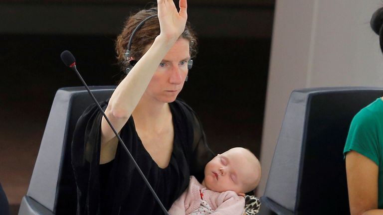 European Parliament Member Anneliese Dodds of the UK holds her baby as she takes part in a voting session at the European Parliament in Strasbourg, France, June 7, 2016. REUTERS/Vincent Kessler