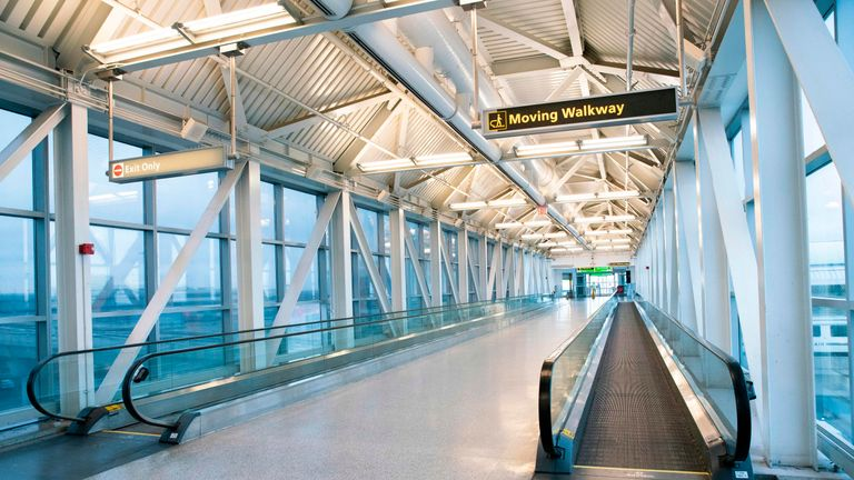 "An empty corridor is viewed at the Terminal 1 section at John F. Kennedy International Airport on March 12, 2020 in New York City. - US President Donald Trump announced a shock 30-day ban on travel from mainland Europe over the coronavirus pandemic that has sparked unprecedented lockdowns, widespread panic and another financial market meltdown Thursday.The announcement came as China, where the outbreak that first emerged in December, showed a dramatic drop in new cases and claimed ""the peak"" of the epidemic had passed. (Photo by Kena Betancur / AFP) (Photo by KENA BETANCUR/AFP via Getty Images)"