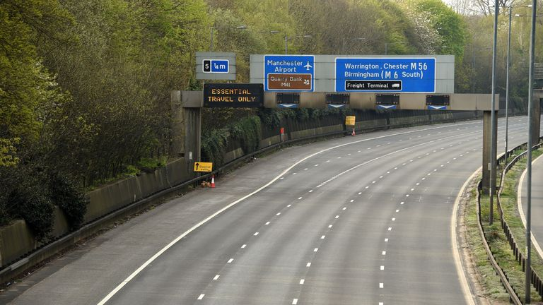 A deserted stretch of the M56 is pictured at the start of the Easter weekend, in north-west England on April 10, 2020 as Britain continued to battle the outbreak of the novel coronavirus COVID-19. - The disease has struck at the heart of the British government, infected more than 60,000 people nationwide and killed over 7,000, with another record daily death toll of 938 reported on April 8. (Photo by Oli SCARFF / AFP) (Photo by OLI SCARFF/AFP via Getty Images)