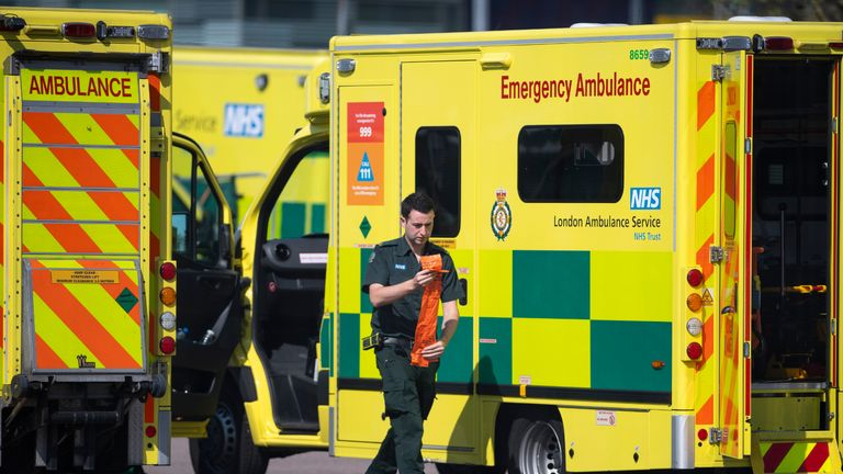 LONDON, UNITED KINGDOM - APRIL 10: A London ambulance worker prepares equipment outside the NHS nightingale hospital at the Excel on April 10, 2020 in London, England. Public Easter events have been cancelled across the country, with the government urging the public to respect lockdown measures by celebrating the holiday in their homes. Over 1.5 million people across the world have been infected with the COVID-19 coronavirus, with over 7,000 fatalities recorded in the United Kingdom.   (Photo by Justin Setterfield/Getty Images)