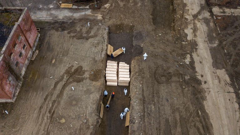 Drone pictures show bodies being buried on New York's Hart Island where the department of corrections is dealing with more burials overall, amid the coronavirus disease (COVID-19) outbreak in New York City, U.S., April 9, 2020. REUTERS/Lucas Jackson