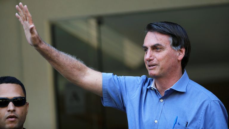 Brazil's President Jair Bolsonaro is seen in a neighborhood Sudoeste, amid the coronavirus disease (COVID-19) outbreak, in Brasilia, Brazil, April 10, 2020. REUTERS/Adriano Machado