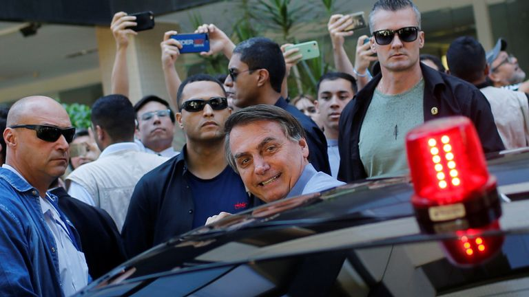 Brazil's President Jair Bolsonaro is seen in a neighbourhood Sudoeste, amid the coronavirus disease (COVID-19) outbreak, in Brasilia, Brazil, April 10, 2020. REUTERS/Adriano Machado