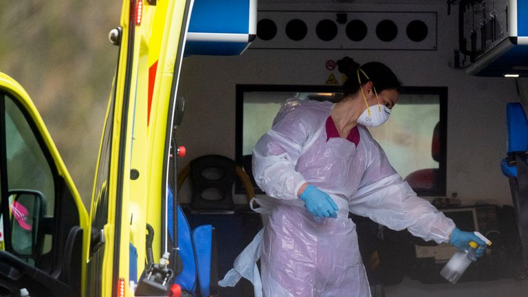 RETRANSMISSION - with corrected first sentence. A London Ambulance worker wearing PPE cleans an ambulance after a patient is brought into St Thomas' Hospital in London as the UK continues in lockdown to help curb the spread of the coronavirus.