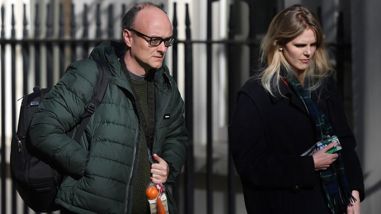 Number 10 special advisor Dominic Cummings (L) arrives with Cleo Watson at 10 Downing Street in central London to attend the Government's daily COVID-19 briefing on April 14, 2020. - The British government warned Monday it would not be lifting a nationwide lockdown anytime soon as the country remains in the grip of a coronavirus outbreak that has claimed more than 11,000 lives. (Photo by JUSTIN TALLIS / AFP) (Photo by JUSTIN TALLIS/AFP via Getty Images)