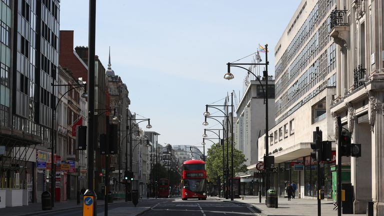 A bus travels along quiet Oxford Street, London, as the UK continues in lockdown to help curb the spread of the coronavirus.