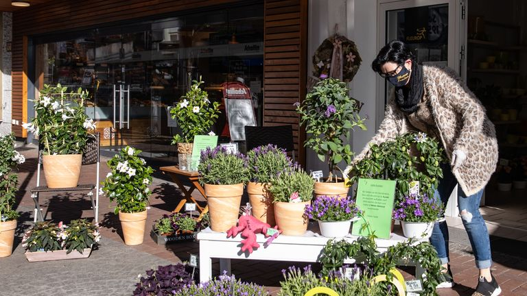 DINSLAKEN, GERMANY - APRIL 20: Owner Heike Landau prepares her florist on the first day of the easing of some restrictions during the coronavirus crisis on April 20, 2020 in Dinslaken, Germany. Across Germany today many states, but not all, are introducing steps to lift restrictions that have had a deep economic and social impact, including the reopening of smaller-size stores, allowing high school students to take exams and restarting production lines in some factories. The number of Covid-19 infections is continuing to rise, but at a slower rate than in previous weeks, which is giving the federal and state governments hope that the time is right to begin lifting restrictions. (Photo by Lars Baron/Getty Images)
