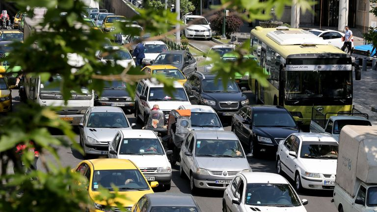 Cars pack a street in the Iranian capital Tehran, on April 18, 2020, after authorities eased lockdown measures due to the COVID-19 pandemic. - Iran allowed some shuttered Tehran businesses to reopen on April 18, despite the Middle East's deadliest coronavirus outbreak, as many faced a bitter choice between risking infection and economic ruin. (Photo by ATTA KENARE / AFP) (Photo by ATTA KENARE/AFP via Getty Images)