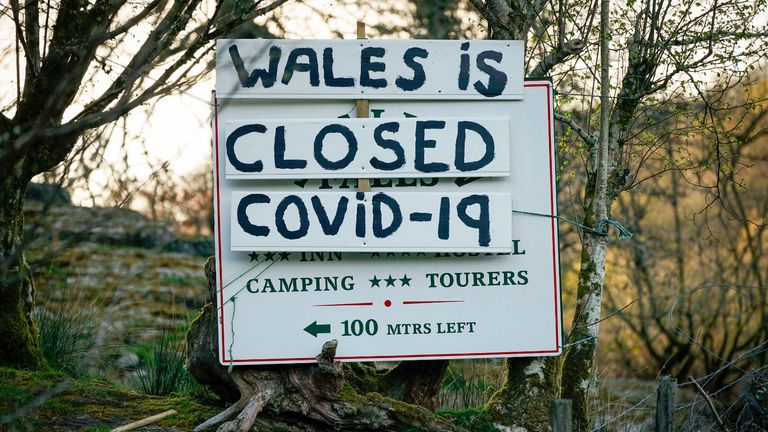 BETWS-Y-COED, WALES - APRIL 08: A sign implores tourists to stay away and that Wales is closed during the pandemic lockdown on April 08, 2020 in Betws-y-Coed, Wales. There have been over 60,000 reported cases of the COVID-19 coronavirus in the United Kingdom and 7,000 deaths. The country is in its third week of lockdown measures aimed at slowing the spread of the virus. (Photo by Christopher Furlong/Getty Images)