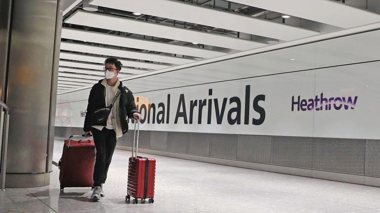 Passengers arrive at Heathrow Airport in London after the last British Airways flight from China touched down in the UK following an announcement that the airline was suspending all flights to and from mainland China with immediate effect amid the escalating coronavirus crisis.