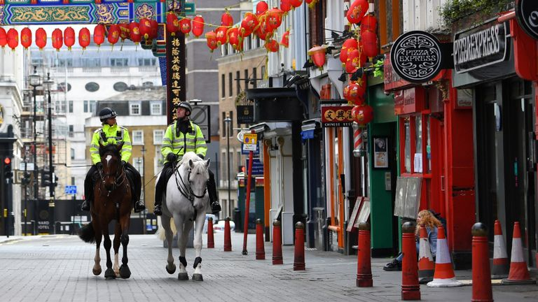 Police on horses in China Town as the spread of the coronavirus disease (COVID-19) continues, London, Britain, March 31, 2020. REUTERS/Dylan Martinez