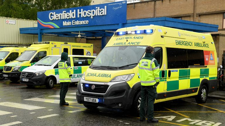LEICESTER, UNITED KINGDOM - APRIL 28:NHS workers are seen during a minute's silence held in memory of NHS workers outside Glenfield Hospital on April 28, 2020 in Leicester, United Kingdom. The moment of silence, commemorating the key workers who have died during the Covid-19 pandemic, was timed to coincide with International Workers' Memorial Day. At least 90 NHS workers are reported to have died in the last month, in addition to transport employees and other key workers. (Photo by Ross Kinnaird/Getty Images)