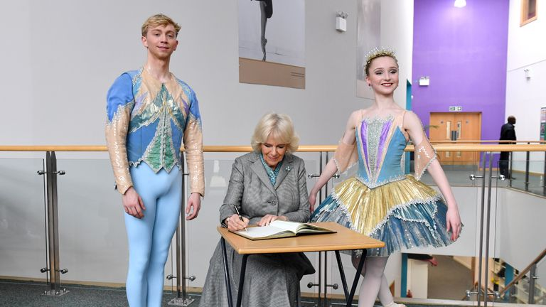 The Duchess of Cornwall signs the visitors' book alongside young ballet dancers during a visit to Elmhurst Ballet School in Birmingham. PA Photo. Picture date: Wednesday January 22, 2020. See PA story ROYAL Camilla. Photo credit should read: Anthony Devlin/PA Wire