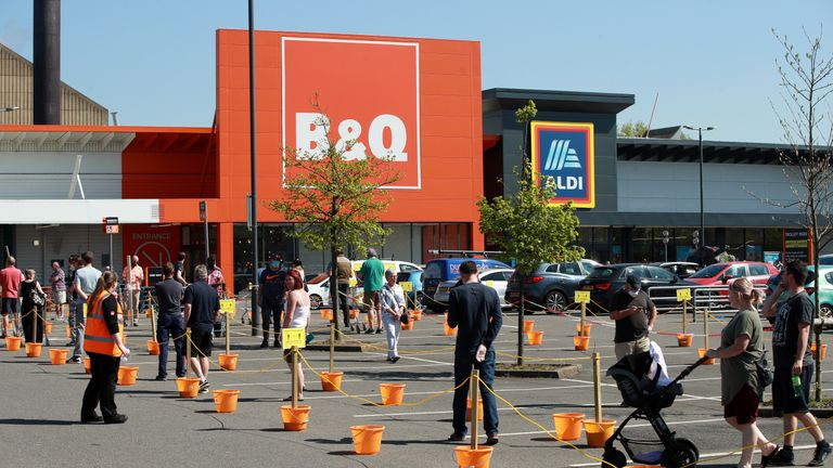 NORTHAMPTON, UNITED KINGDOM - APRIL 24: Shoppers queue at a recently re-opened B&Q hardware store on April 24, 2020 in Northampton, United Kingdom. The British government has extended the lockdown restrictions first introduced on March 23 that are meant to slow the spread of COVID-19. (Photo by David Rogers/Getty Images)
