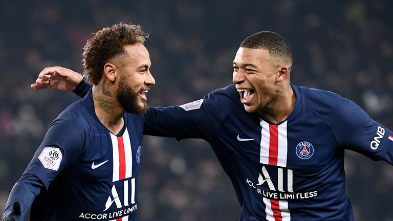 Paris Saint-Germain's French forward Kylian Mbappe (R) is congratulated by Paris Saint-Germain's Brazilian forward Neymar (C) after scoring a goal during the French L1 football match between Paris Saint-Germain (PSG) and FC Nantes (FCN) at the Parc des Princes in Paris, on December 4, 2019. (Photo by FRANCK FIFE / AFP) (Photo by FRANCK FIFE/AFP via Getty Images)