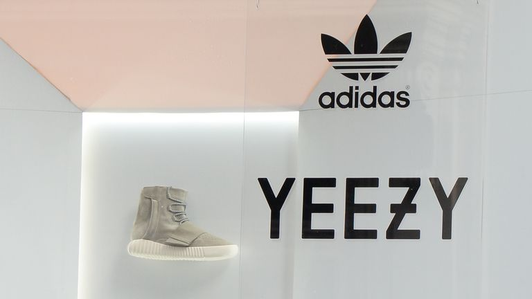 A single 'Yeezy' sneaker is seen in a window in Soho, New York City