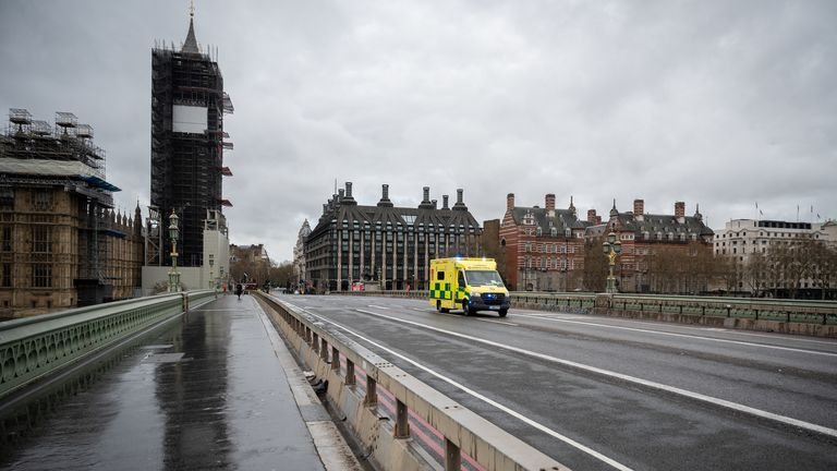 An ambulance rushes across Westminster Bridge as it travels to St Thomas' hospital